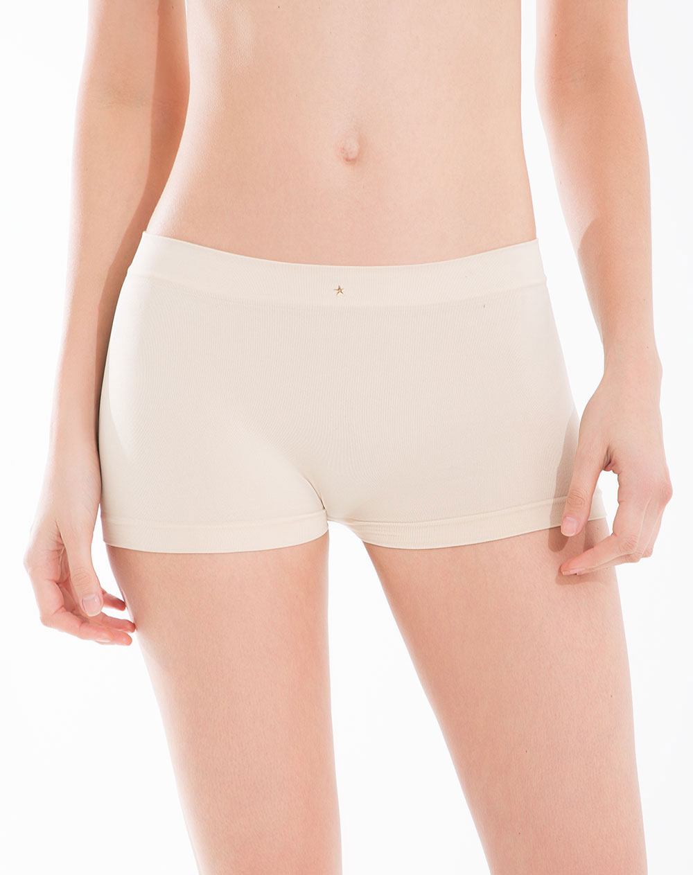 model in light-tan form-fitting underwear